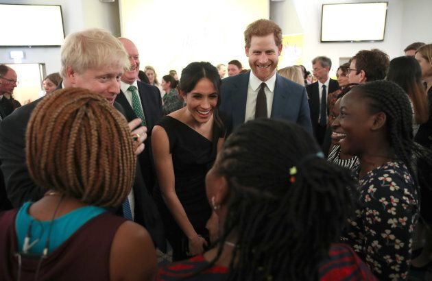 Meghan Markle and Prince Harry speak with guests as they attend the Women's Empowerment