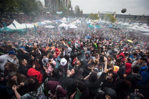 A cloud of smoke hangs over the crowd as thousands of people smoke marijuana during the 4-20 annual marijuana...