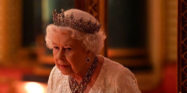 Queen Elizabeth arrives to The Queen's Dinner during the Commonwealth Heads of Government Meeting at...