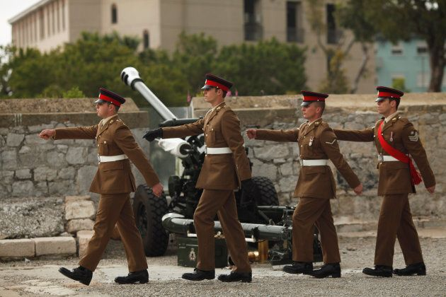 Members of the Royal Gibraltar Regiment march after firing a 21-gun salute to mark the 92nd birthday...