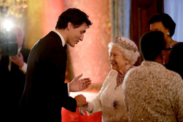 Queen Elizabeth II greets Prime Minister Justin Trudeau in a receiving line for the Queen's Dinner for...