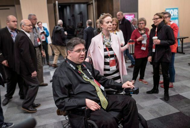 Kent Hehr, left, MP for Calgary Centre, arrives with his wife Deanna Holt before attending a workshop...