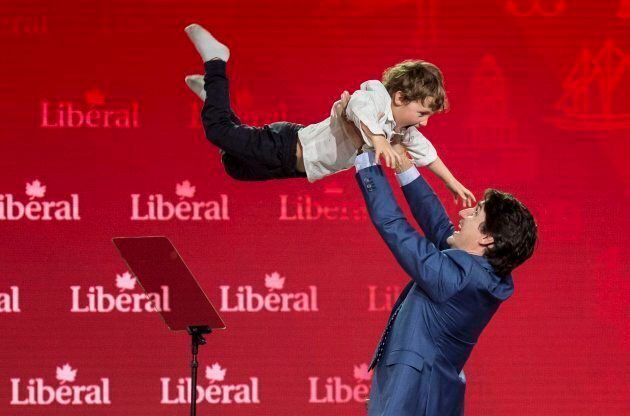 Prime Minister Justin Trudeau lifts his son Hadrien into the air after his speech at the Liberal national...