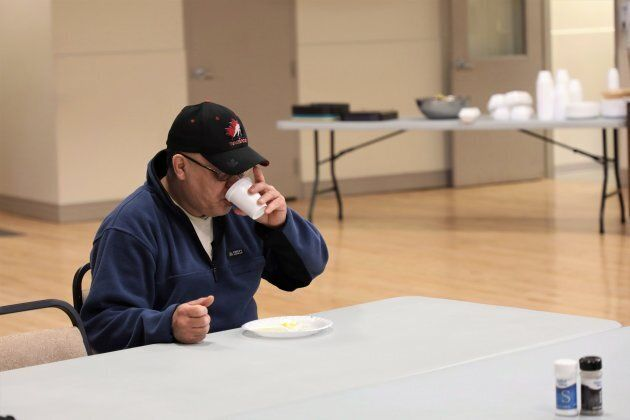 Paul Edwards, of the James Bay community of Fort Albany, Ont., eats breakfast in the auditorium of the...