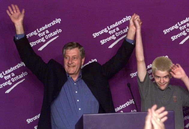 Mike Harris and his son Mike Jr. wave to the crowd during his victory speech in his home riding of North...