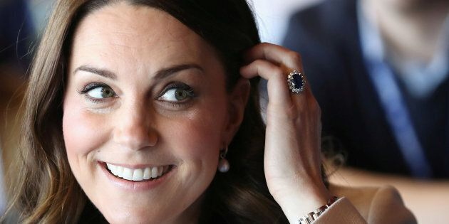 Britain's Catherine, Duchess of Cambridge takes part in a Commonwealth Quiz during her visit to the Copper...