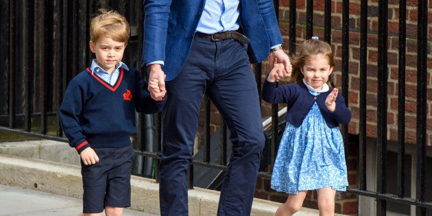 The Duke of Cambridge with Prince George and Princess Charlotte outside the Lindo Wing at St Mary's Hospital...