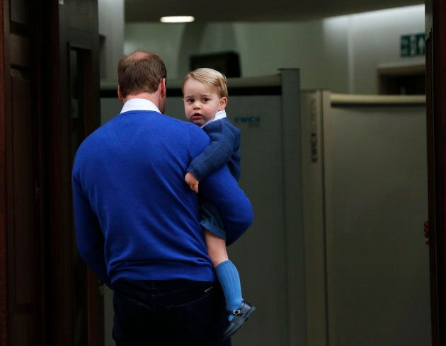 Britain's Prince William returns with his son George to the Lindo Wing of St Mary's Hospital, after the...