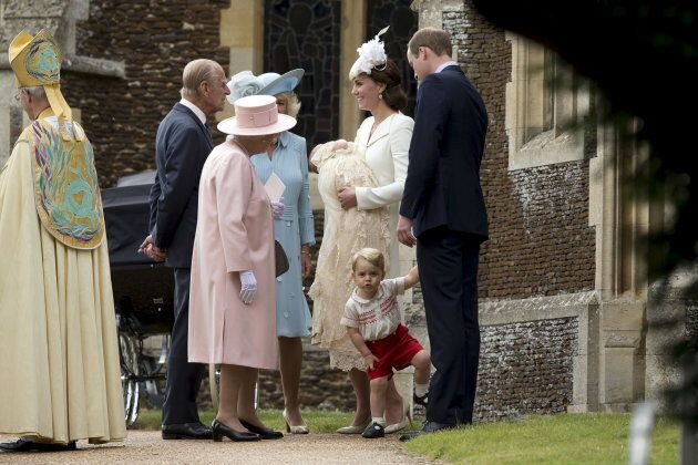 Britain's Queen Elizabeth is seen standing with her husband Prince Philip, Camilla, Duchess of Cornwall, Catherine, Duchess of Cambridge, Princess Charlotte, Prince George and Prince William after the christening of Princess Charlotte at the Church of St. Mary Magdalene in Sandringham, Britain July 5, 2015.