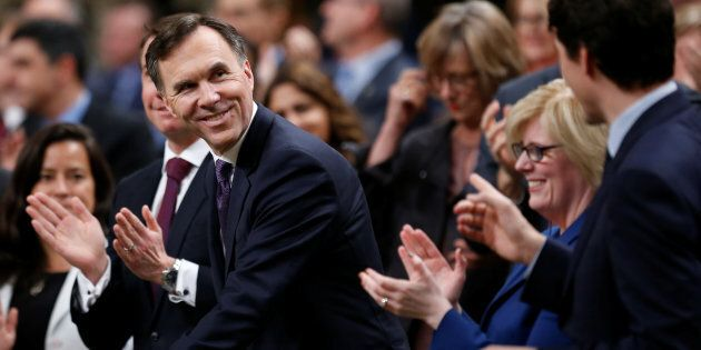 Finance Minister Bill Morneau receives a standing ovation as he arrives to deliver the budget in the...