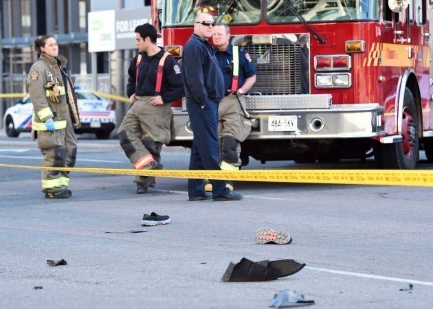Shoes lay in the street as first responders secure the area in Toronto after a van mounted a sidewalk...