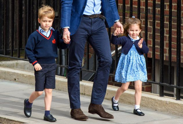 The Duke of Cambridge with Prince George and Princess Charlotte outside the Lindo Wing at St Mary's Hospital.
