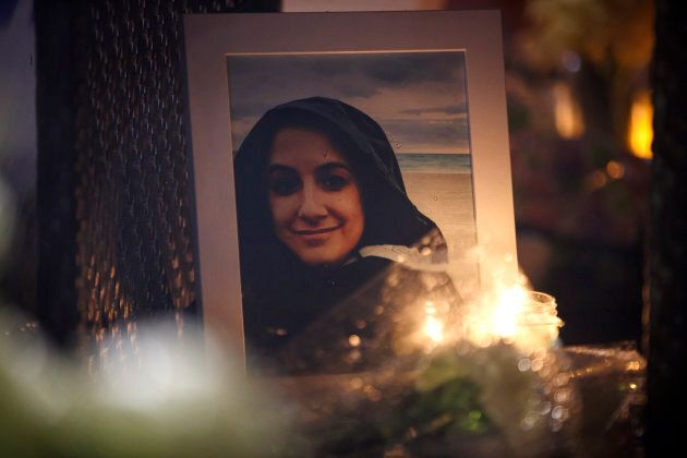 A photograph of Anne Marie D'Amico is shown at a vigil on April 24, 2018 in