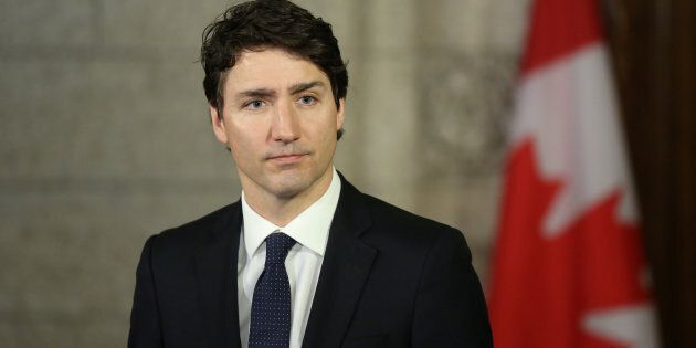 Prime Minister Justin Trudeau listens on Parliament Hill on April 24,