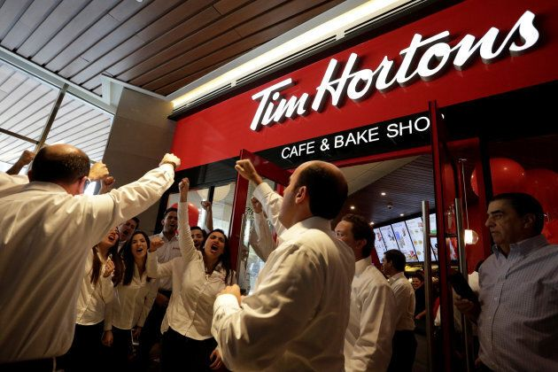 Tim Hortons' executives react during the opening of a Tim Hortons coffee shop in San Pedro Garza Garcia,...