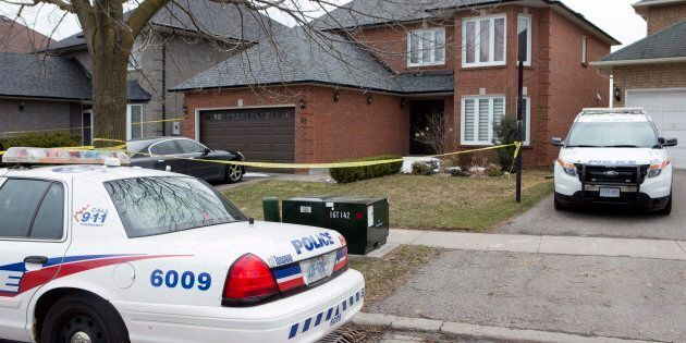 Police cars remain parked outside of the Toronto area home of Alek Minassian in Richmond Hill, Ont.,...