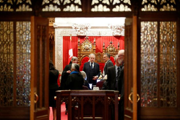 Senators wait for the start of a vote in the Senate chamber on Parliament Hill in Ottawa on March 22,
