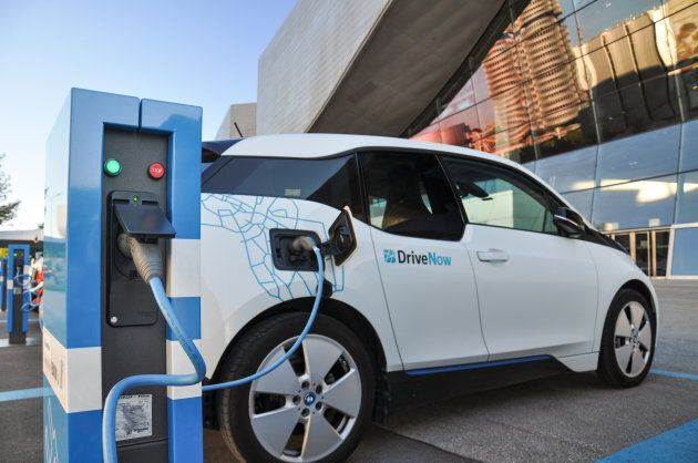 A 'DriveNow' BMW i3 electric car being charged at a charging station at 'BMW Welt' near BMW headquarters...