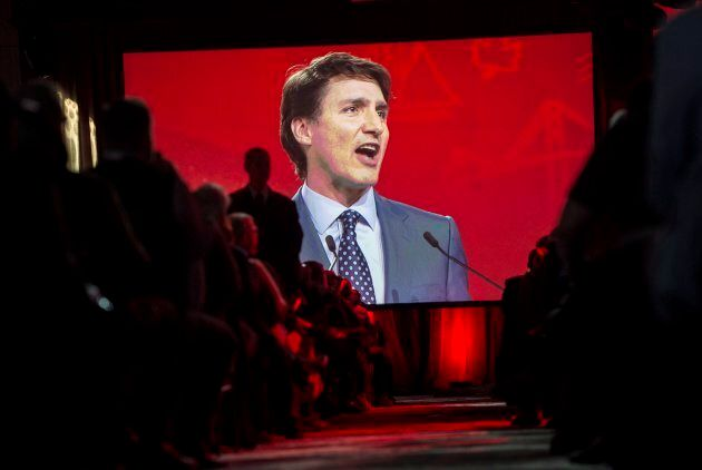A video screen shows the image of Prime Minister Justin Trudeau as he delivers a speech at the federal Liberal national convention in Halifax on April 21, 2018.