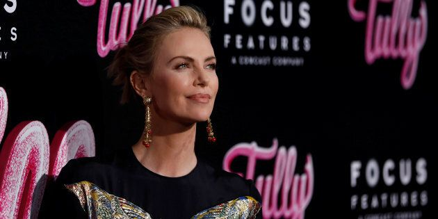 Charlize Theron poses at the premiere for