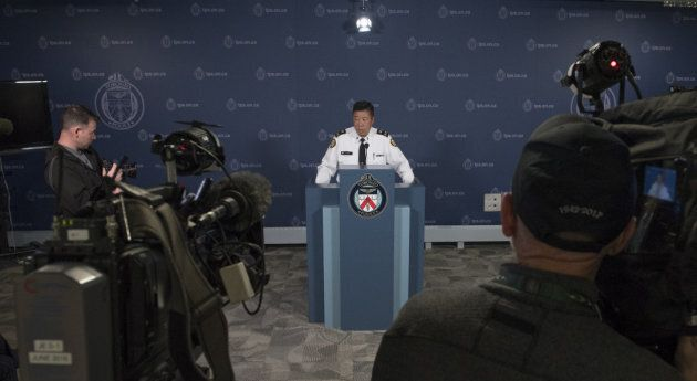 Toronto police Deputy Chief Peter Yuen speaks to reporters about Const. Ken Lam, the officer who arrested...