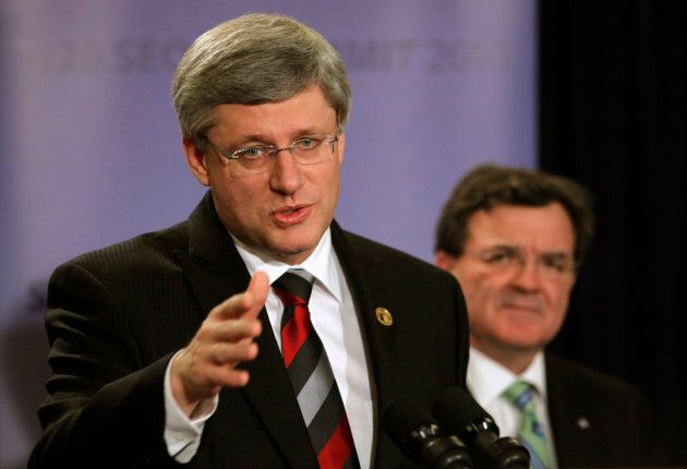 Former Prime Minister Stephen Harper, left, gestures as he speaks next to then-Finance Minister Jim Flaherty, right, at a news conference at the G20 Summit in Seoul on Nov. 12, 2010.