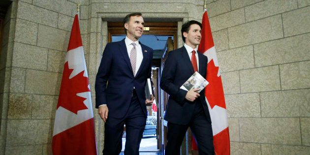 Prime Minister Justin Trudeau, right, and Finance Minister Bill Morneau, left, walk from Trudeau's office...