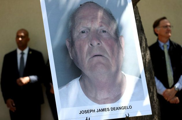 A photo of accused rapist and killer Joseph James DeAngelo is displayed during a news conference on April...