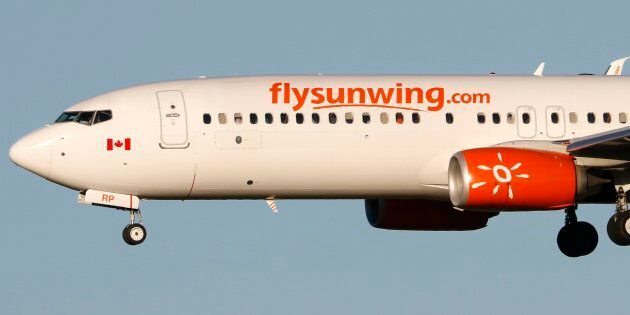 A Boeing 737-800 jetiner belonging to Canadian carrier Sunwing Airlines lands in Calgary, Alta., July...