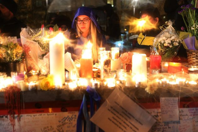 A candle light vigil is held on April 24 at Olive Square near Yonge and Finch Streets for the 10 people...