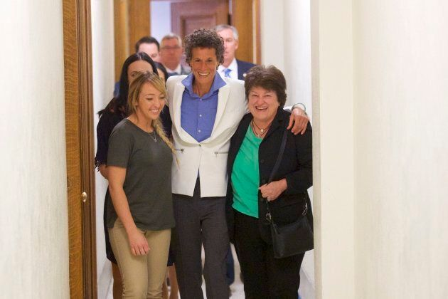 Bill Cosby accuser Andrea Constand, centre, reacts after the guilty on all counts verdict was delivered...