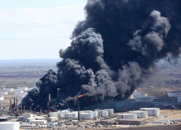Dark smoke rises from Husky Energy oil refinery following an explosion in Superior, Wisconsin, U.S.,...