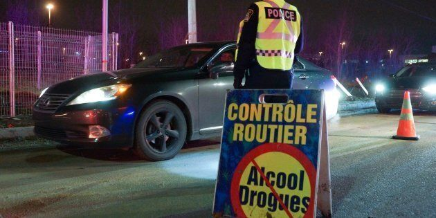 Police units from Montreal's north shore conducting a drug and alcohol checkpoint in Laval, Que. on Nov. 30, 2017.