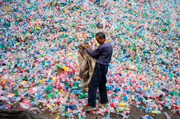 A Chinese labourer sorting out plastic bottles for recycling on the outskirt of Beijing on Sept. 17,