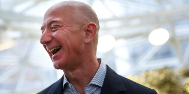 Amazon founder and CEO Jeff Bezos laughs as he talks to the media while touring the new Amazon Spheres during the grand opening at Amazon's Seattle headquarters in Seattle, Wash., Jan. 29, 2018.
