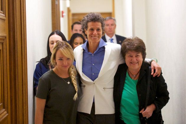 Bill Cosby accuser Andrea Constand (C) reacts after the guilty on all counts verdict was delivered in...