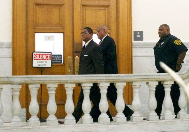 Bill Cosby (C) walks to the courtroom to hear the verdict at the Montgomery County