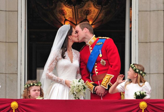 The Duke and Duchess of Cambridge kiss on the balcony of Buckingham Palace on April 29, 2011.