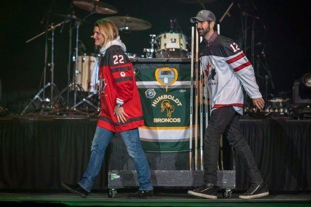 Olympian Hayley Wickenheiser places a hockey stick on a Humboldt Broncos jersey during the Country Thunder...