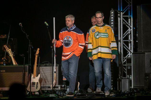 Edmonton Oilers head coach Todd McLellan, left, and Chris Joseph, who lost his son Jaxon in the crash,...