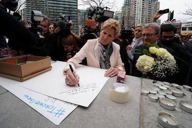 Ontario Premier Kathleen Wynne visits a makeshift memorial a day after a van struck multiple people along...