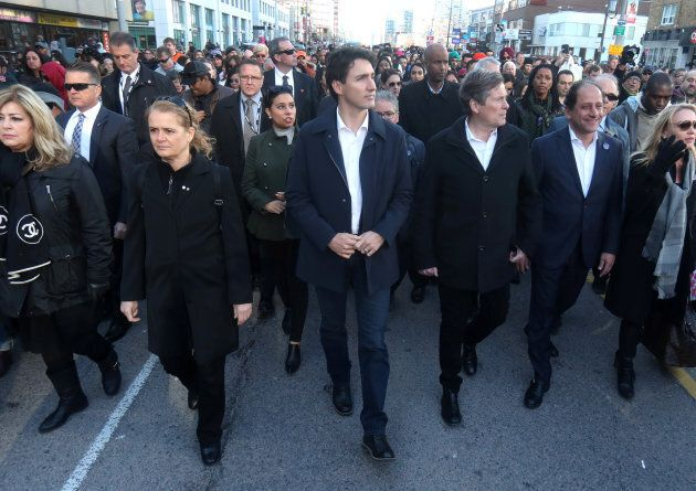 Prime Minister Justin Trudeau, Governor General Julie Payette and Toronto Mayor John Tory walk with crowds...