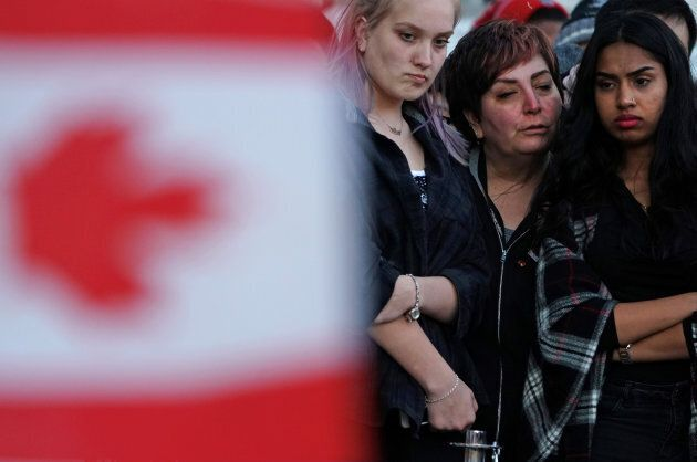 Mourners at the vigil for the victims of the Toronto van attack on