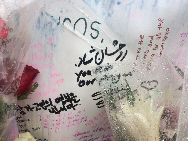 Messages written on a poster at a memorial in