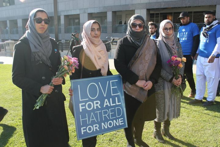Hena Malik, second from right, and friends attend the 'Toronto Strong' vigil in North York on April 29, 2018.