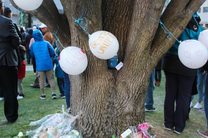 Balloons blow in the wind during a vigil for the victims of last week's deadly van attack in Toronto on April 29, 2018.