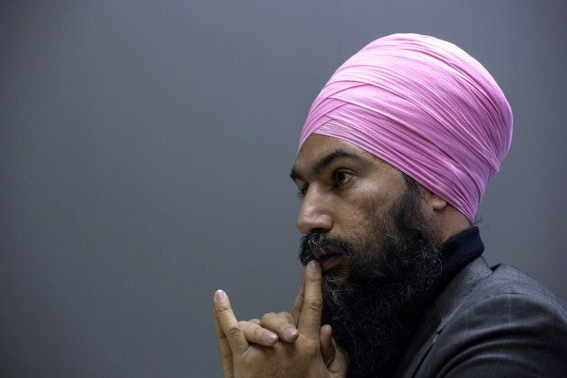NDP Leader Jagmeet Singh pauses while speaking during an interview in Ottawa on Dec. 7,