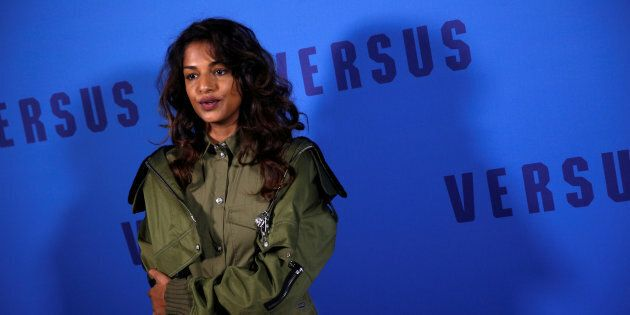 Musician M.I.A. poses for photographers at the Versus catwalk show during London Fashion Week Feb. 18,