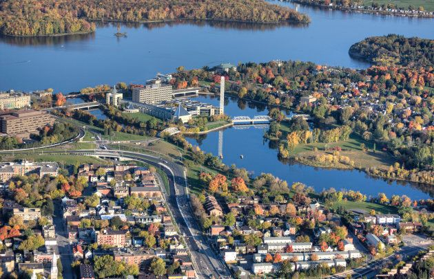 An aerial view of Ottawa's old City Hall, surrounded by residential neighbourhoods.