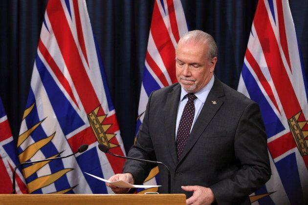 Premier John Horgan, Attorney General David Eby and Environment Minister George Heyman meet with media...